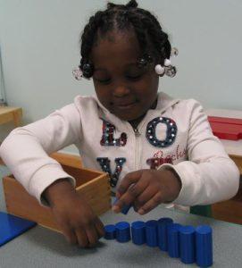Montessori Student with size puzzle